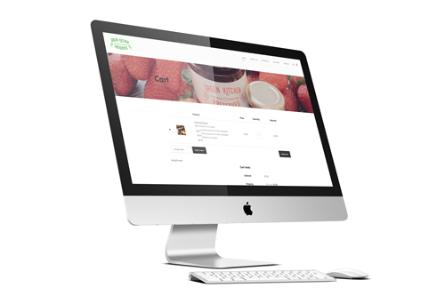 iMac computer displaying Ecommerce website shopping cart page