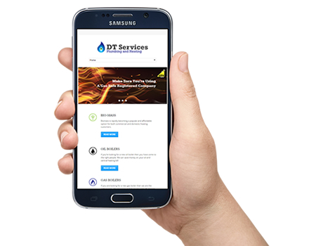 a hand holding a mobile phone showing a responsive website design for a plumbing company