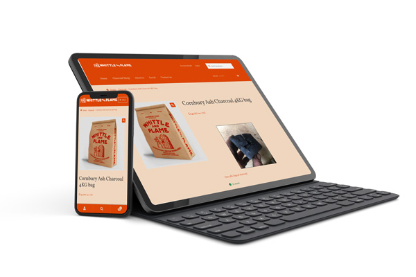 responsive website mockup showing the whittle and flame ecommerce website design on two devices