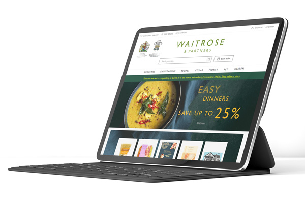 a tablet on a white background displaying the waitrose website