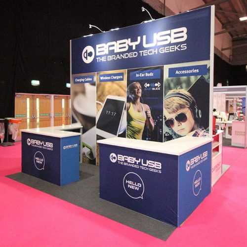 Baby USB Exhibition Stand at Merchandise World, Ricoh Arena Coventry, Featuring Large Tension Fabric Back Wall and Counter top product displays