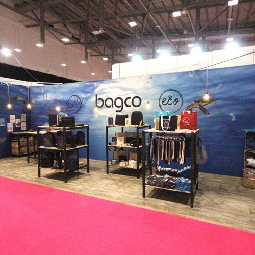 Bagco Exhibition Stand at Merchandise World, Ricoh Arena, Coventry Using Large Tension Fabric Graphics, Suspended Lighting and Custom Built Rustic product display stands