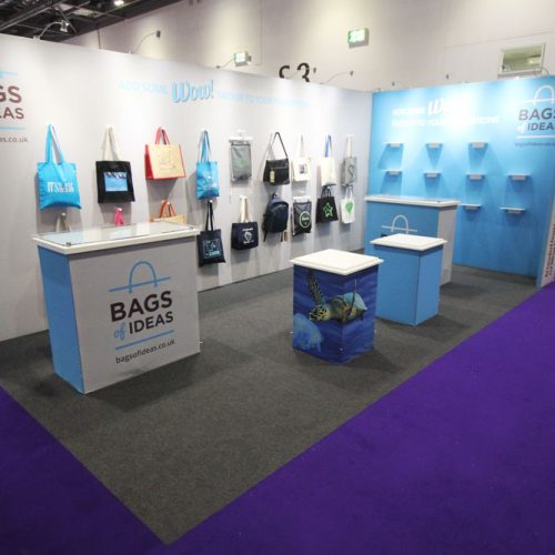 Bags of Ideas Tension Fabric Exhibition stand at Confex 2020, London ExCeL, featuring magnetic bags hooks and shelving, with reception desks and product display plinths