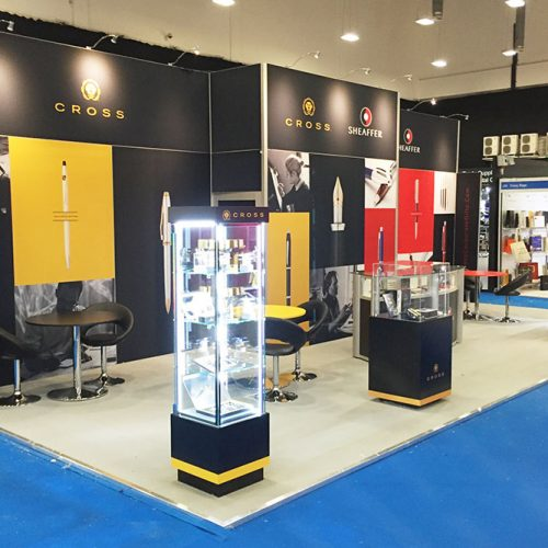 Cross Pens Exhibition Stand, Tension Fabric back wall and store room, large reception desk, and bespoke product display units on a raised platform floor