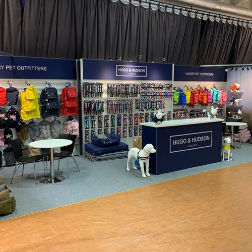 Hugo and Hudson Exhibition stand at PATS 2020, featuring tension fabric graphics, large slatwall display areas and magnetic shelf display areas