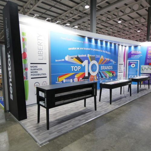 Senator Pens Custom Built Exhibition Stand, feature long banner wrapped walls, a large store area, buzz wire game, and 3 large display units for pen display
