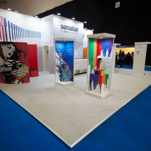 A large Custom Built Exhibition Stand, with banner wrapped walls, bespoke seating areas and for feature installations demonstrating specific products
